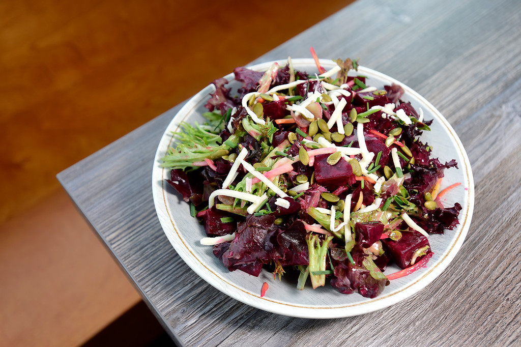 . LONGMONT, CO - JANUARY 30:Roast It Beet Salad with roasted beets, mixed baby greens, charred red onions, carrots, pepitas, honey dijon vinaigrette shown here with vegan mozzarella cheese at Collision Brewing Company and restaurant in Longmont on Jan. 30, 2019. (Photo by Matthew Jonas/Staff Photographer)