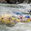 Whitewater rafters plunge into big waves at Troublemaker Rapid, South Fork American River, Coloma.