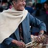 Man selling onions at the Saturday market, Villa de Leyva, Colombia.