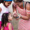 Traveler shows girls photos on her cell phone, Pijiño del Carmen, Colombia.