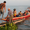 Travelers embark boat on the Magdalena River, Colombia.