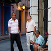Men chatting on a winding colonial street, Cartagena, Colombia