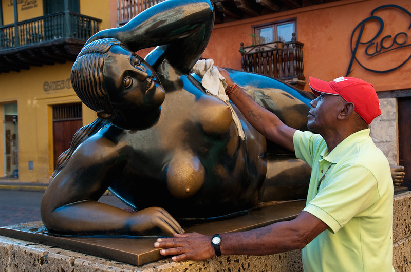 """Every day, Sixto Santoya cleans """"Gertrudis,"""" sculpture by Fernando Botero, Cartagena, Colombia."""