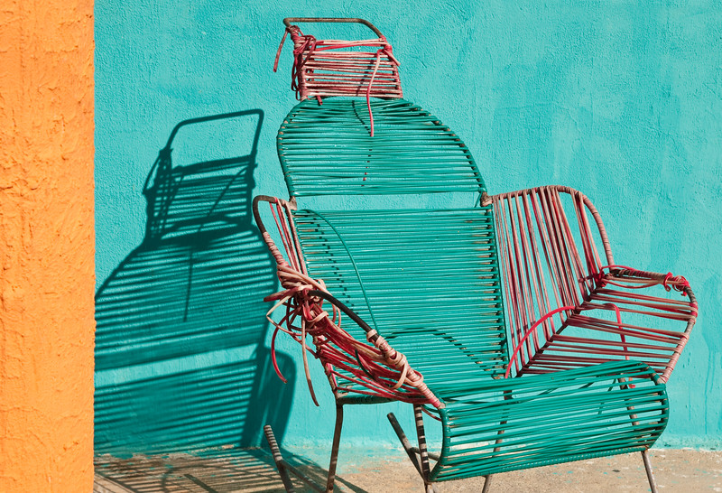 Colorful chair by a colorful house, Santa Marta, Colombia.