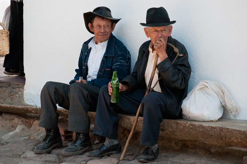 Elderly men sitting on a ledge, Villa de Leyva, Colombia.