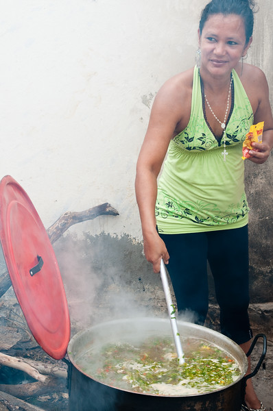 Woman cooks sancocho over an open fire, Mompox (Mompós), Colombia.