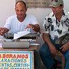Street typist produces a document for customer, Cartagena, Colombia