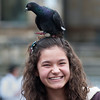 Teenage girl with pigeon in Plaza de Bolívar, Bogota, Colombia