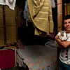 Boy with rabbit in his shanty town home, Ibagué, Colombia