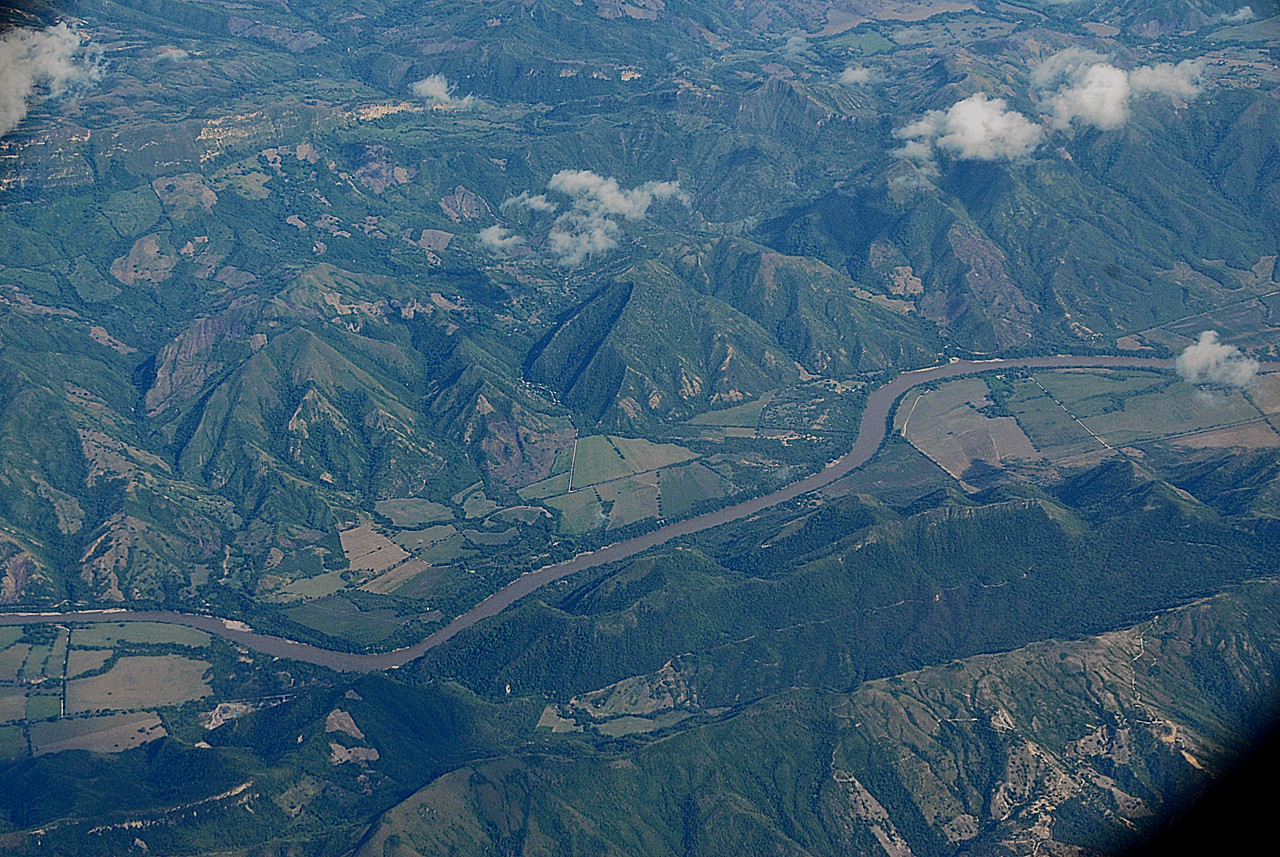 The flights go at right angles over the mountain ranges, some of whose peaks rise above 18,000 feet.  They then hug the valleys. Below is the Patia River in Narino and which empties into the Pacific.