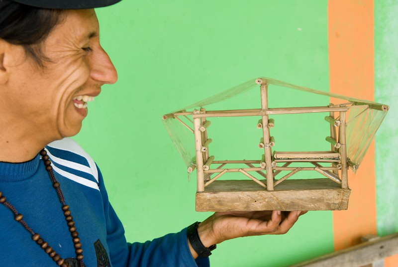 This is Harold Dominguez owner of Casa Quemada.  He holds a model he made of a structure for drying coffee beans.