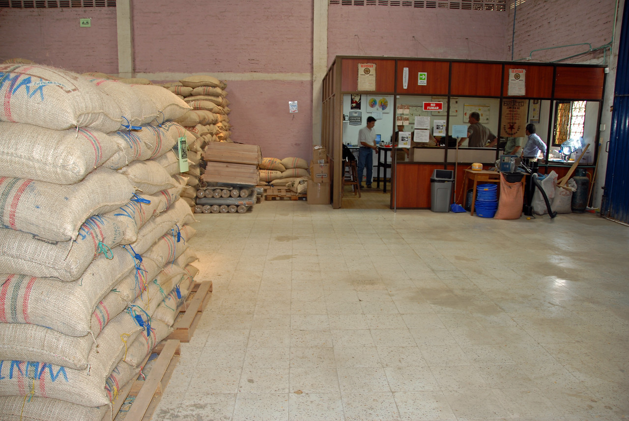 This is Viramax's warehouse in Popayan.  Here they receive deliveries of coffees from the region still in parchment, a paper-like yet highly protective envelepe-skin which sheathes the raw coffee bean.  In back is their cupping room where all coffees are thoroughly assessed for cup quality before being accepted.