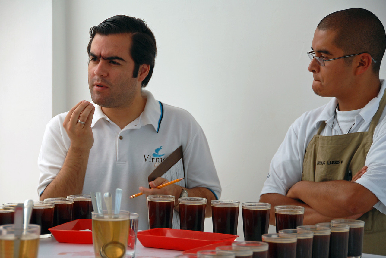 Inside Alejandro Cadena explains the flavor profile he is tasting in Nariño's coffees.  To his right is Wbeimar (pronounced as if there were no B) Lasso, at that time an apprentice cupper and coffee buyer for Virmax.  Wbeimar's relatives are all coffee farmers in Narino.