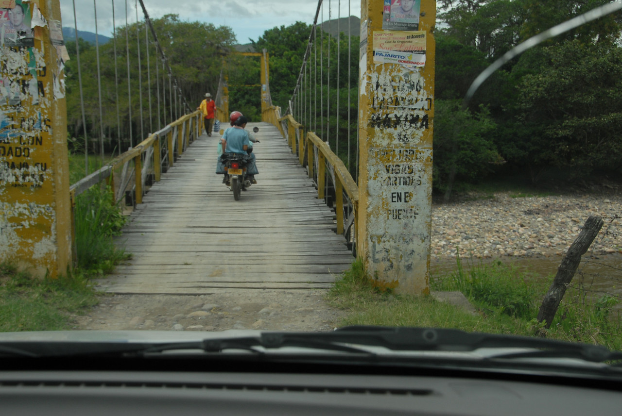 We follow Isaias and his son on motorcycle over this bridge.....
