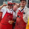 At the big market in Bogata, a couple of butchers pose with pig's head.