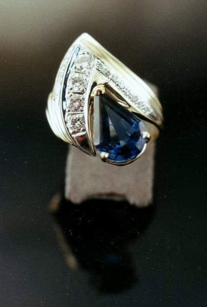 Another shot of the London Blue Topaz and diamonds set into a ring that was made using the Lost Wax Casting method and gold the client already owned. Good detail shot of the Topaz.
