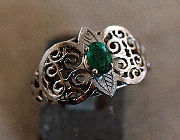 Pierced Platinum and Emerald ring.