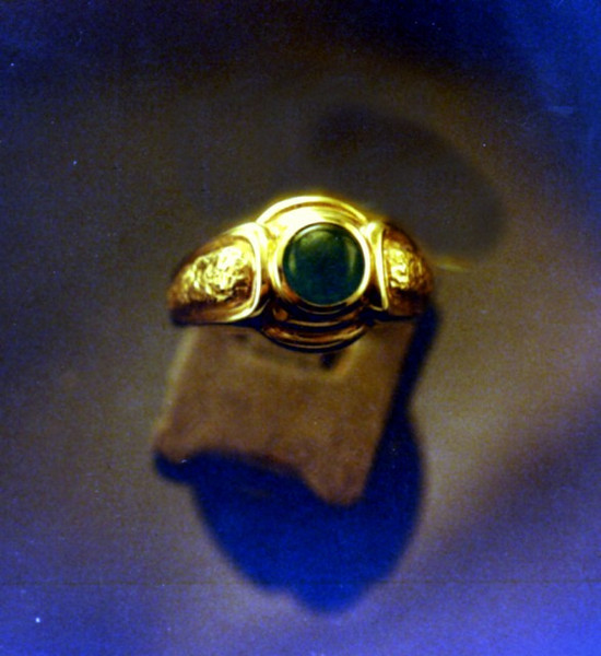 "Cabochon cut emerald bezel set into a cast ring. It can be a little treacherous to ""fold"" the gold onto an emerald with such close tolerances."