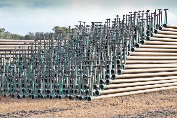 Stacked Irrigation Pipes with Sprinkers