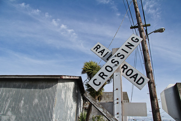 Railroad Crossing Sign and Telephone Pole
