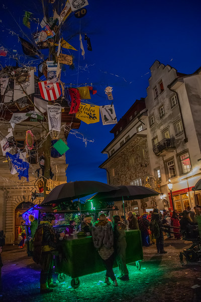 Kornmarkt at Fasnacht. Market square in the old town of Luzern, Switzerland, celebrating Carnival, let's have a drink, cheers!