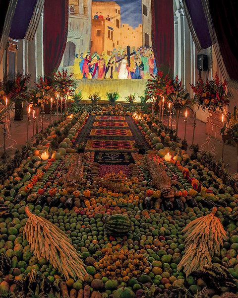 Velacion in Antigua. Altar with sandust carpets and fruits, synergie of mayan and spanish catholic traditions, to honor the image of Christ for the Lent and Holy Week festivities, Antigua Guatemala, UNESCO World Heritage.