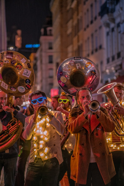 Lights and music. Brass band playing in the old strees of Lyon, France, for the light festival, Fete des Lumières.