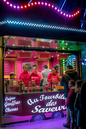 Midnight Sweet and Sour. Colorful stand with sweets below the Ferris Wheel for the Fete des Lumieres, Lyon, France.