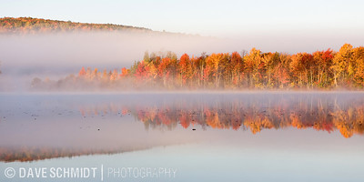 A cold early morning in October during peak foliage at Lake Iroquois.  October, 2008.  Williston, Vermont.