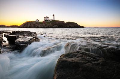Sunrise over Nubble Lighthouse in Cape Neddick, Maine.