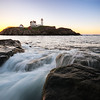 Sunrise over Nubble Lighthouse in Cape Neddick, Maine.