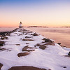 Sunrise on the Spring Point Ledge Lighthouse and sea smoke on Casco Bay in South Portland, Maine.