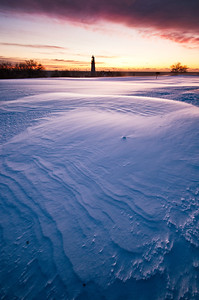 Snow patterns at the Portland Head Lighthouse at Fort Williams in Cape Elizabeth, Maine.