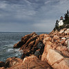 Storm clouds gather behind the Bass Harbor Head Lighthouse, Acadia National Park, Maine.