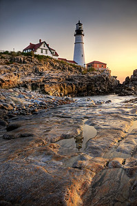 Warm glow of the rising sun on the Portland Head Lighthouse in Cape Elizabeth, Maine