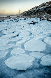 Pancake ice forms in sub zero temperatures at the Spring Point Ledge Lighthouse in South Portland, Maine.