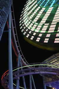 Wheels and lines. Minato Mirai amusement park. Yokohama. The red and green lines come from a roller coaster car. Nikon Ai-s 25-50mm f4 on a D700. The lens is perhaps 30 years old, but still a nice performer.