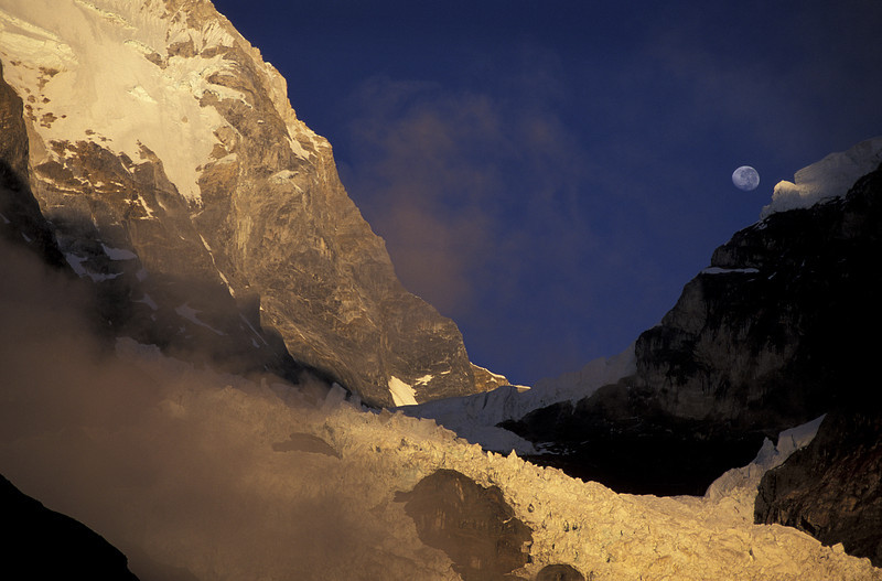 Moon rise over the mountains of Peru <br /> Granite, Ice and Clouds mix to make up one of the most dramatic ranges in the world, the Cordilliara Huyhuash. As the evening sun dipped, I captured the moon rising behind the peaks.
