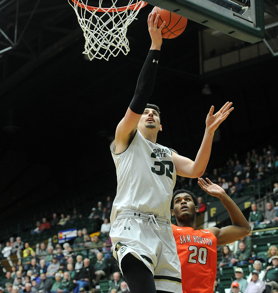Nico Carvacho finishes a layup against Sam Houston State on Saturday, Dec. 8, 2018 at Moby Arena. (Colin Barnard/Loveland Reporter-Herald)