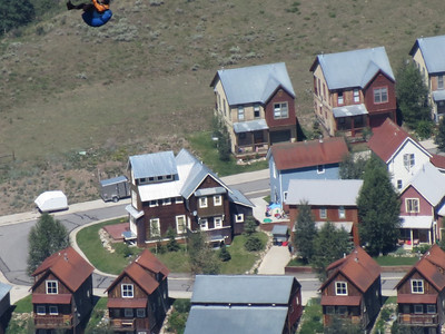The hang-glider up in the corner over the town of Mount Crested Butte.