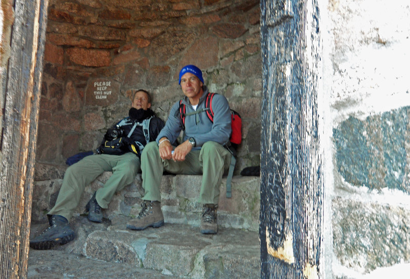 Dan and Keith, taking a brief rest in the warming hut. Smile, Keith! (Image: Kurth Hansen)