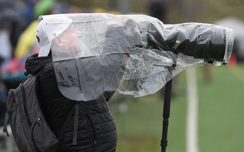 Photographer, Dan Madden, keeps the wet out. The Colorado Buffaloes women's lacrosse team wins the Pac-12 after beating Oregon 19-9 in Boulder on Friday.<br />  Cliff Grassmick / Staff Photographer/<br /> April 19, 2018