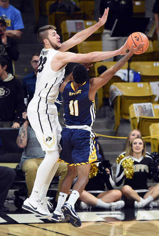 . Lucas Siewert, of CU, blocks the shot of Andre Spight, of UNC, during the November 10th, 2017 game in Boulder.  Cliff Grassmick / Staff Photographer/ November 10, 2017, 2017