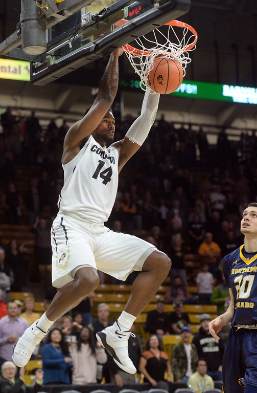 . Tory Miller-Stewart, of CU, gets a break away dunk against UNC during the November 10th, 2017 game in Boulder.  Cliff Grassmick / Staff Photographer/ November 10, 2017, 2017