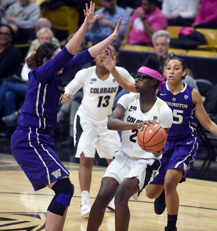 . Mya Hollingshed, of CU, looks to pass on Washington.   Cliff Grassmick / Staff Photographer/ February 16, 2018