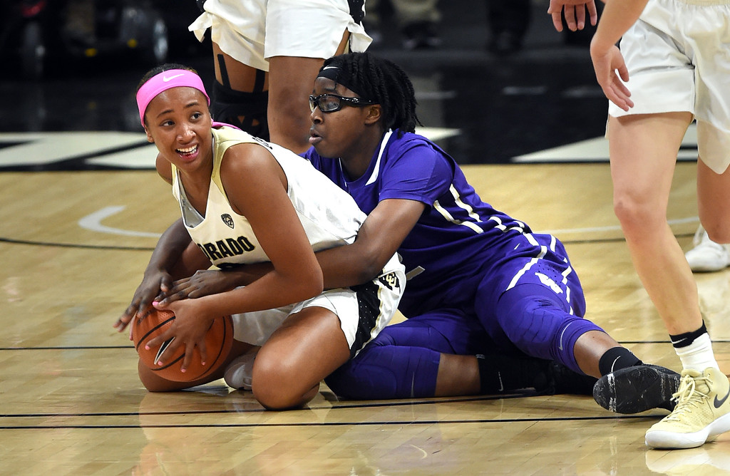 . Quinessa Cayao-Do, of CU, tries to keep the ball from Fapou Semebene, of Washington.   Cliff Grassmick / Staff Photographer/ February 16, 2018