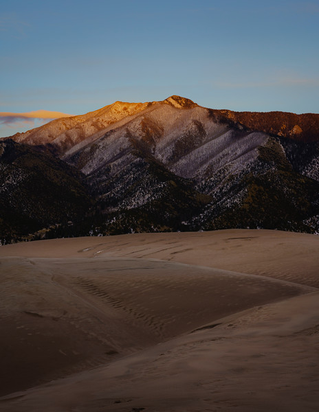 The setting sun casts its rays on the Sangre de Christo Mountains, Great Sand Dunes NP