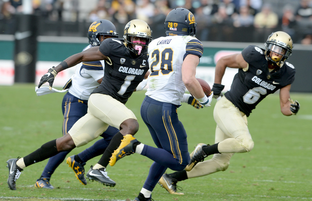 . Afolabi Laguda (1) and Evan Worthington, have Patrick Laird, of Cal, in their sites during the CU Cal Homecoming game on Saturday.  Cliff Grassmick / Staff Photographer/ October 28, 2017