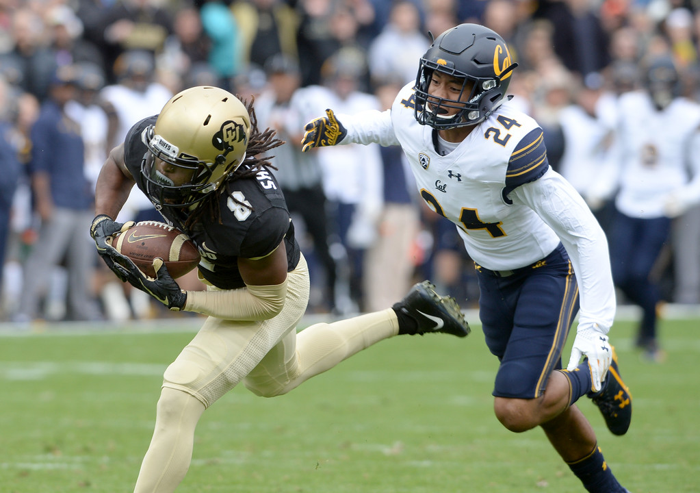 . Laviska Shenault, Jr. of CU, makes a long catch past Camryn Bynum, of Cal, during the CU Cal Homecoming game on Saturday.  Cliff Grassmick / Staff Photographer/ October 28, 2017