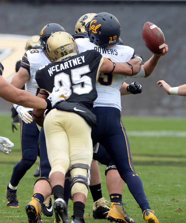 . Derek McCartney, of CU, separates the ball from Ross Bowers, of Cal, during the CU Cal Homecoming game on Saturday.  Cliff Grassmick / Staff Photographer/ October 28, 2017